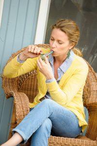 white female inhaling marijuana